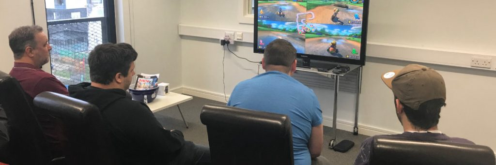 SockMonkey Employees Playing Games in the Office